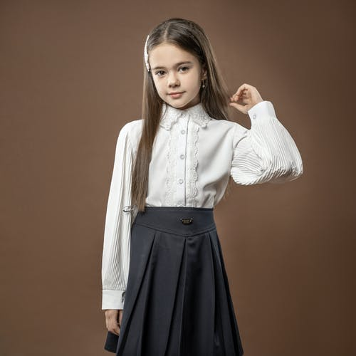 Woman in White Long Sleeve Shirt and Blue Skirt