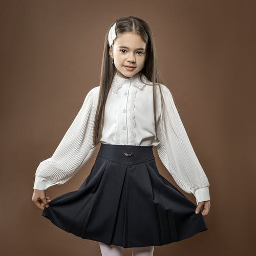 Woman in White Cardigan and Black Skirt