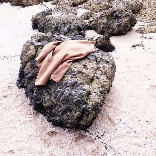 Brown Coat on Black Stone