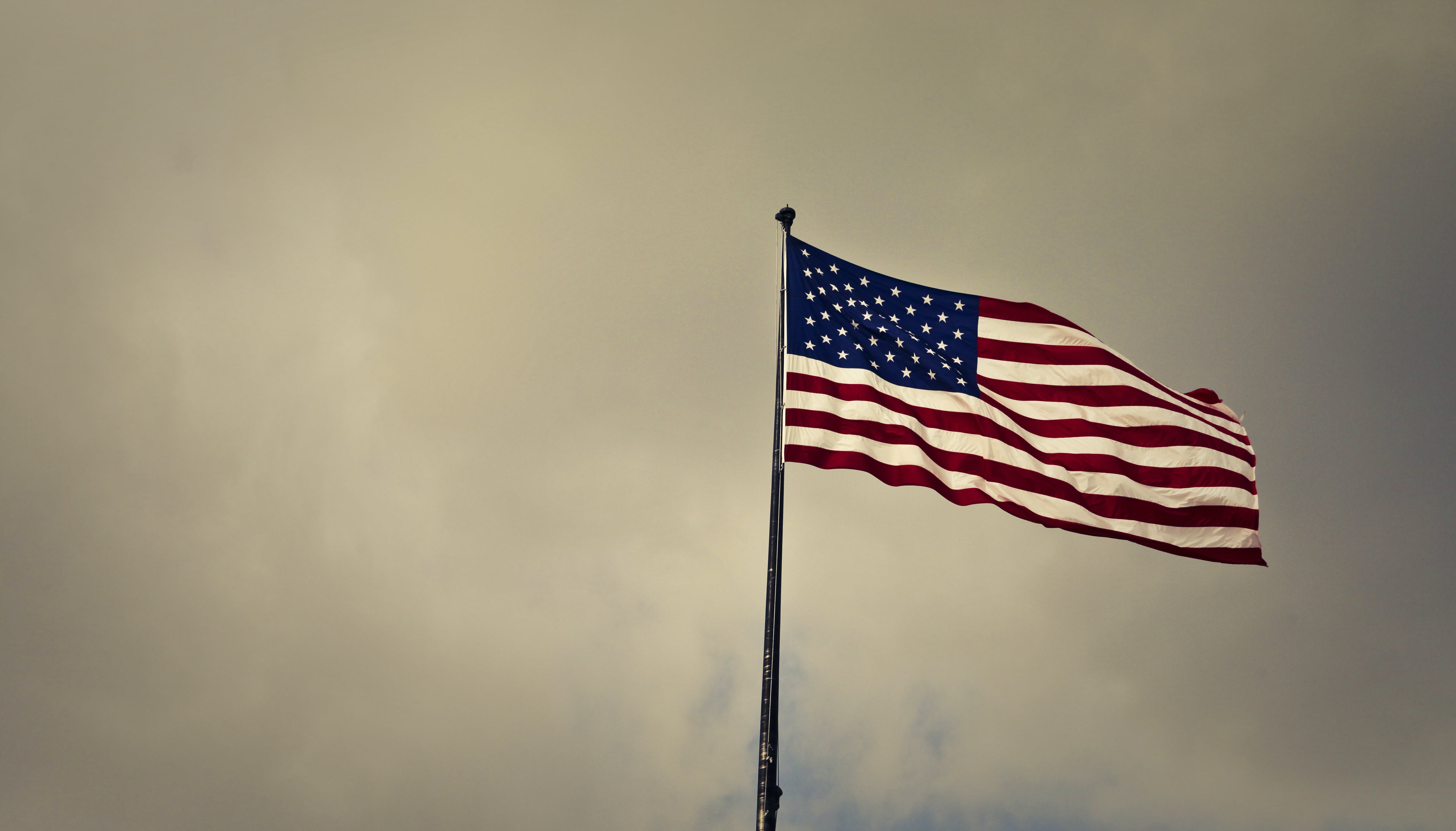 Photo of Cloudy Skies over American Flag