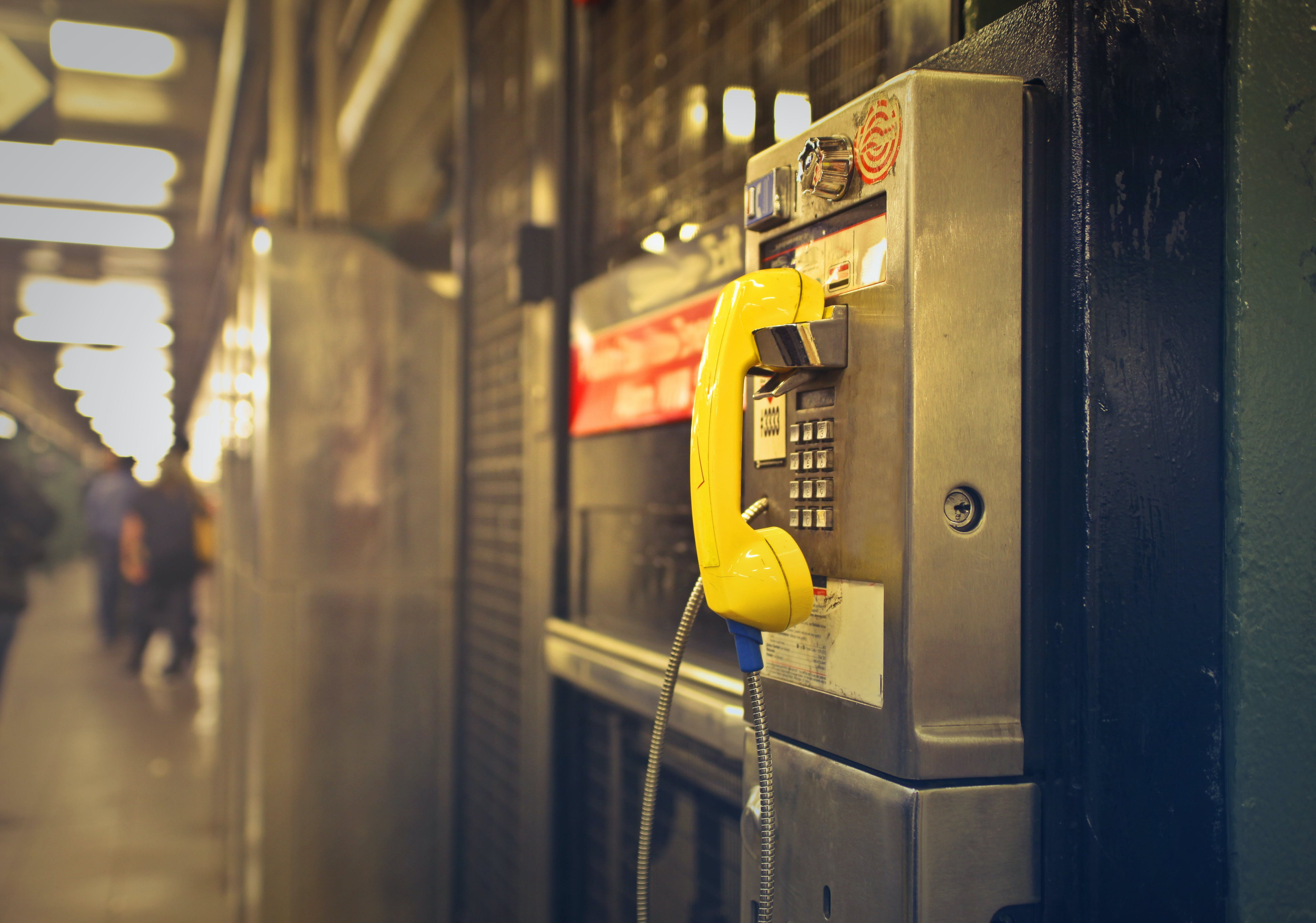 Yellow and Gray Telephone Booth