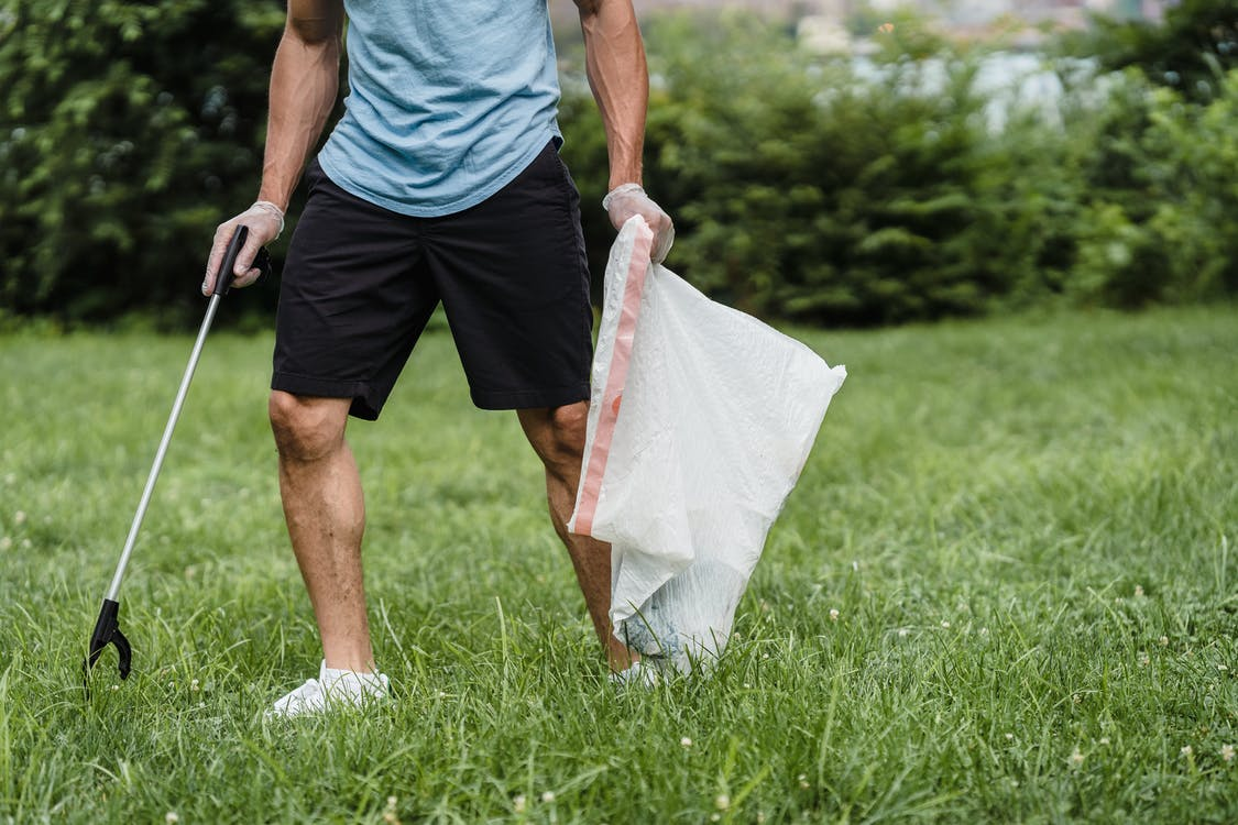 adult, litter picking, cleaning up, saving the planet
