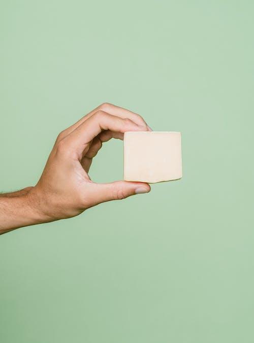 Person Holding White Square Paper