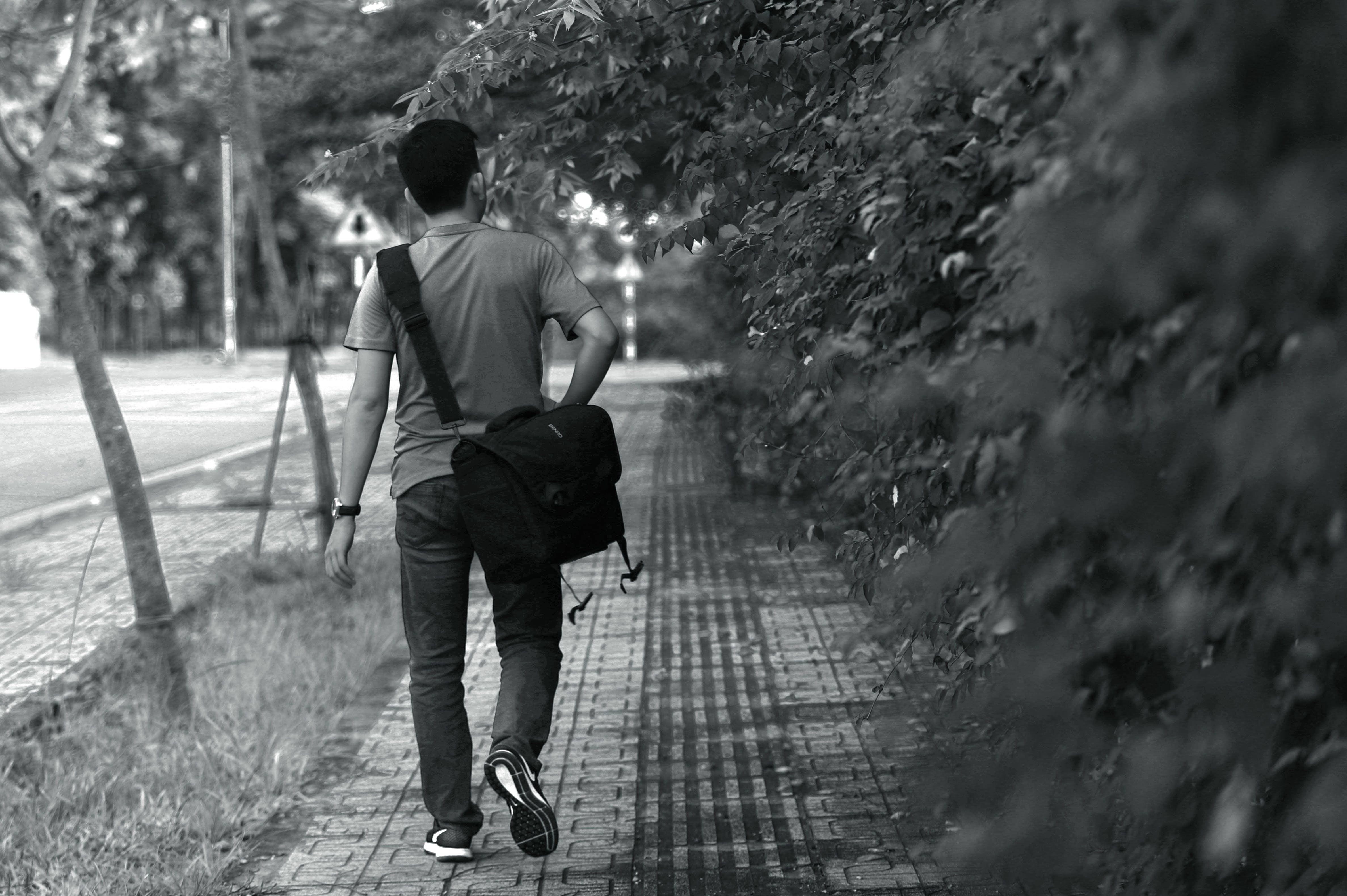 Man Wearing T-shirt; Pants; Crossbody Bag
