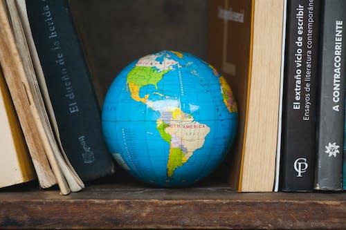 A Globe in Between Books