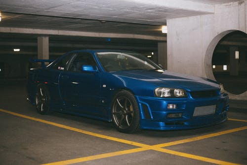 A Blue Nissan Skyline GT-R Parked in a Parking Lot