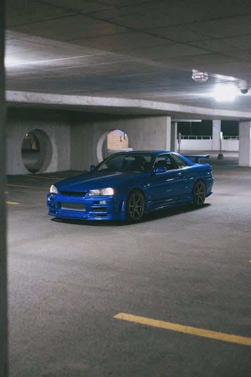 A Blue Nissan Skyline GT-R in a Parking Lot