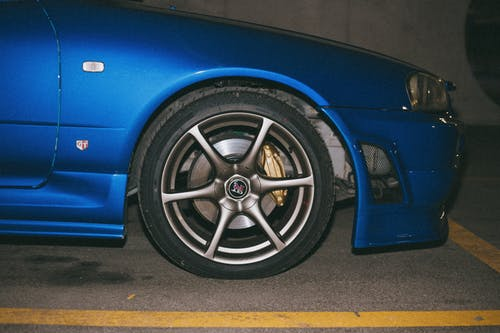 Rim of a Blue Nissan Skyline GT-R Parked in a Parking Lot