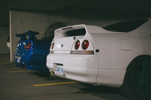 Rear Part of Two Nissan Skyline GT-R Parked Next to Each Other