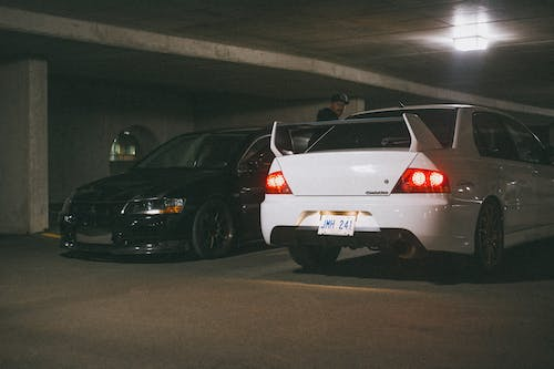 Two Mitsubishi Lancer Evolution Parked Next to Each Other