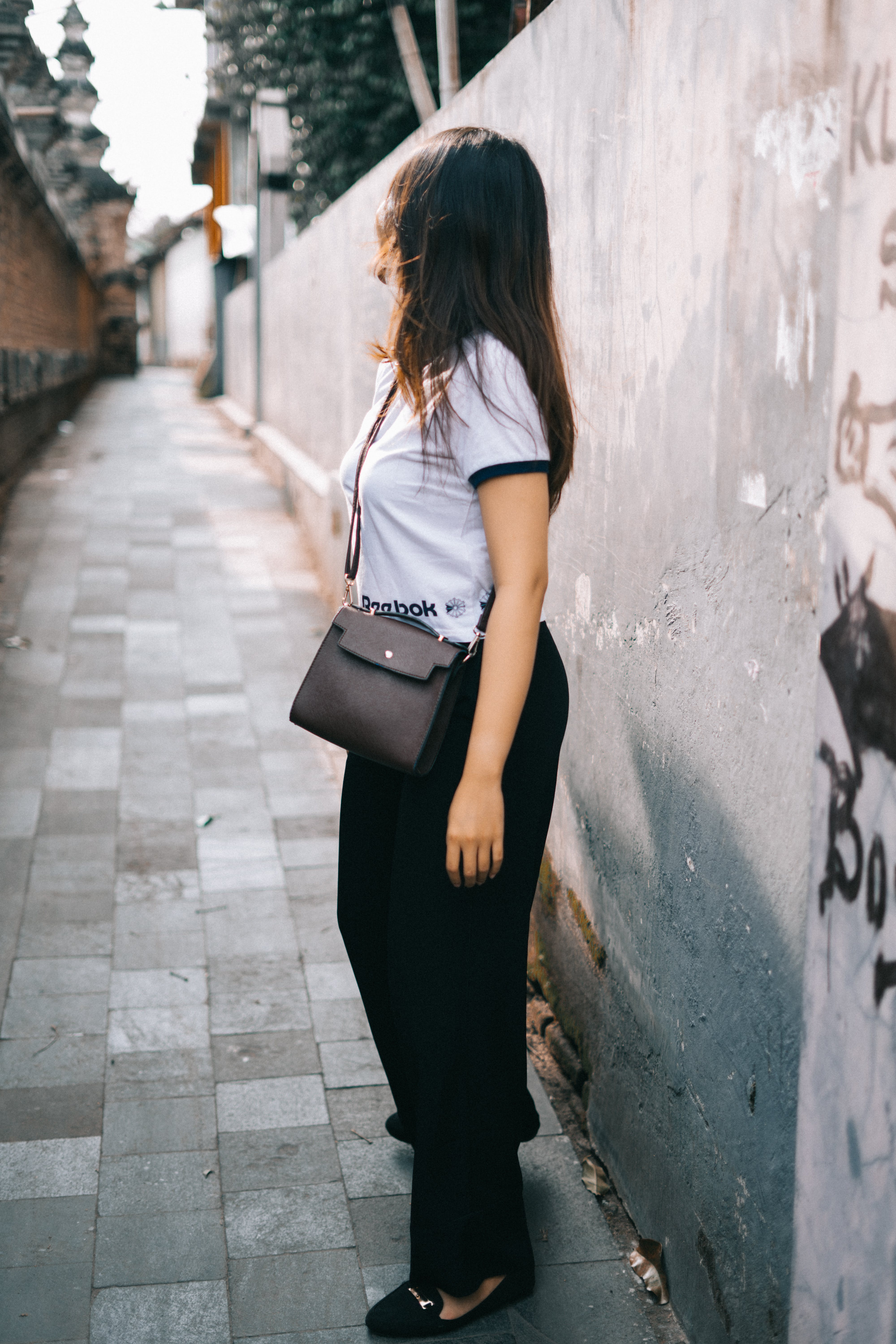 Woman Wearing Black and White T-shirt and Black Pants