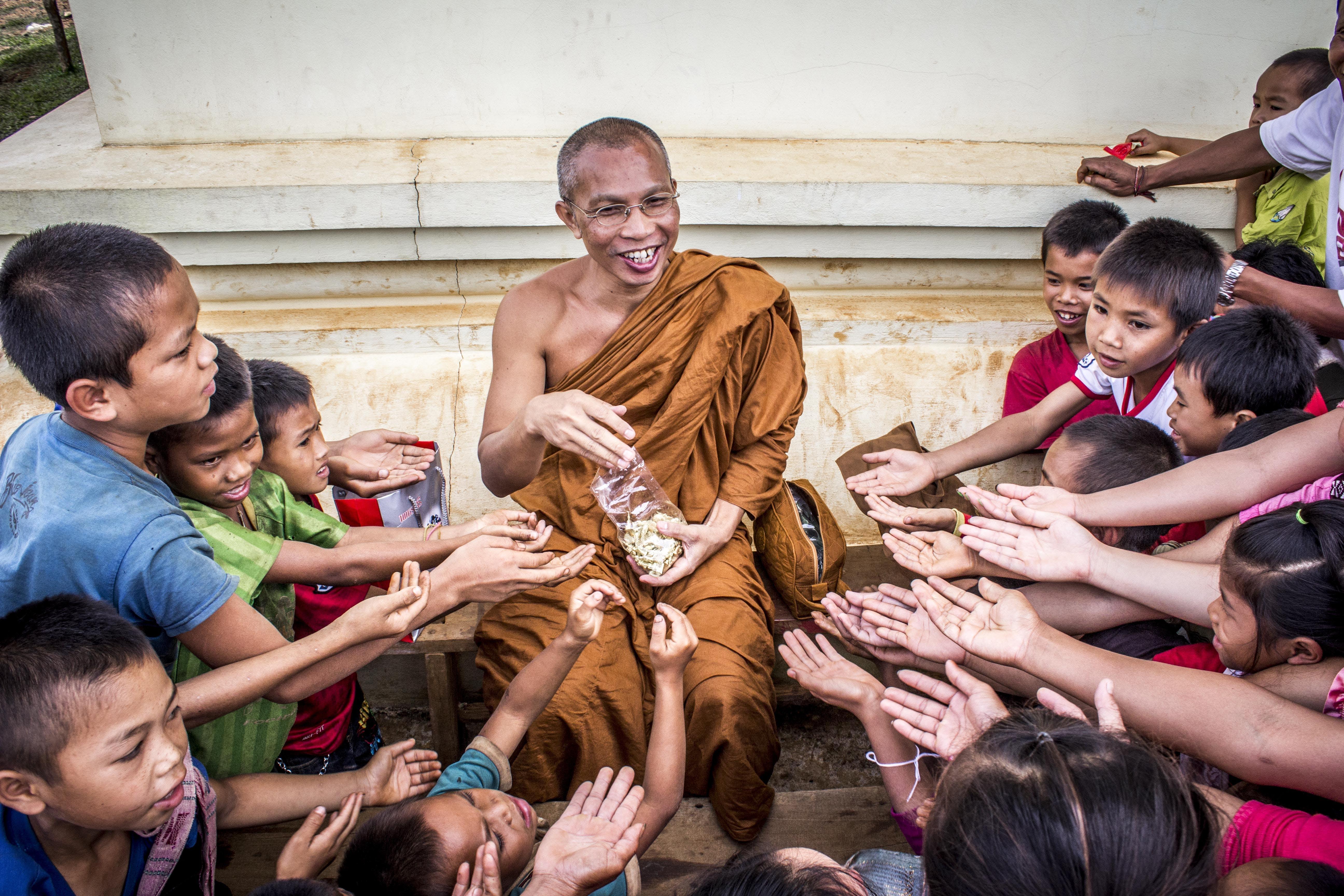 Man in Monk Dress Between Group of Children