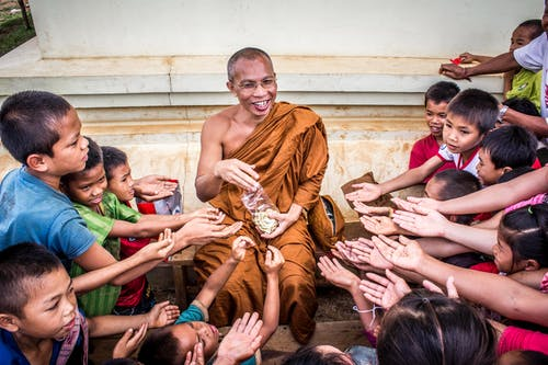 Man in Monk Dress Between Group of Children