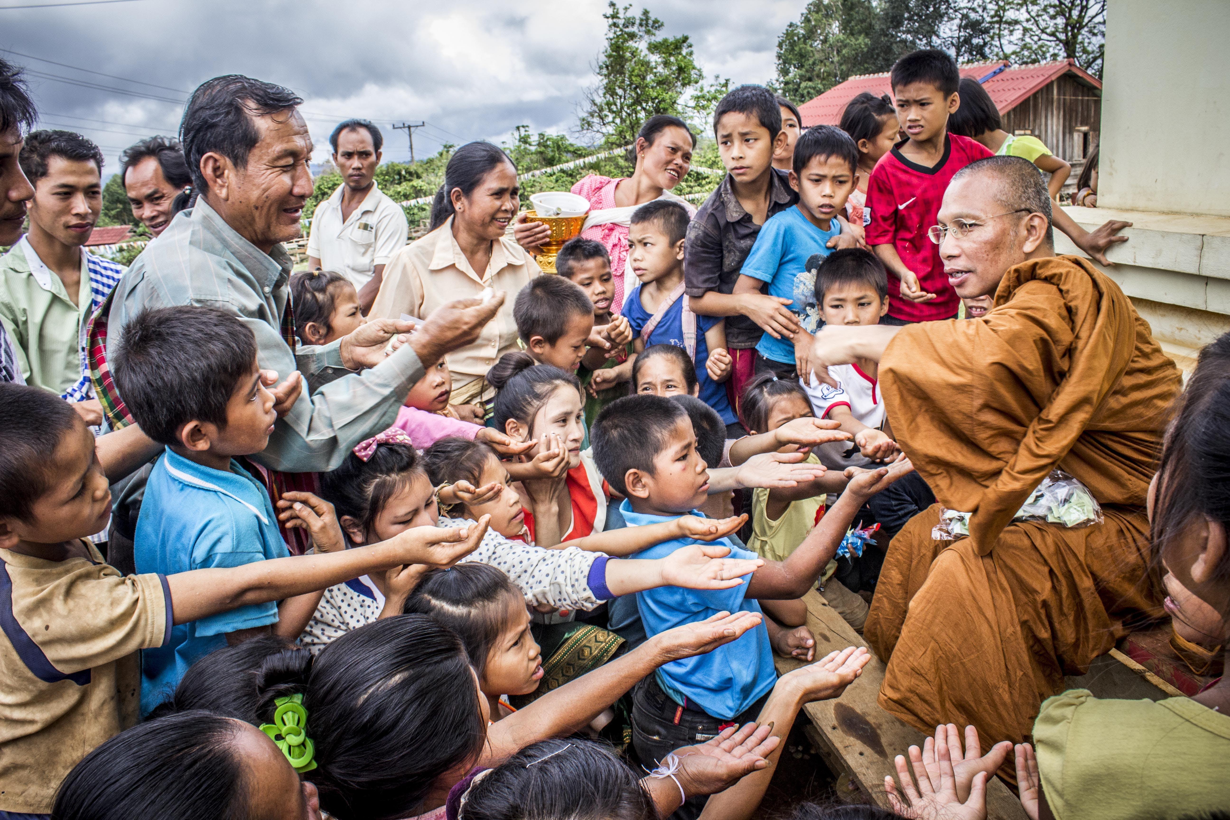 Group of Children Raising Their Palm Towards a Man