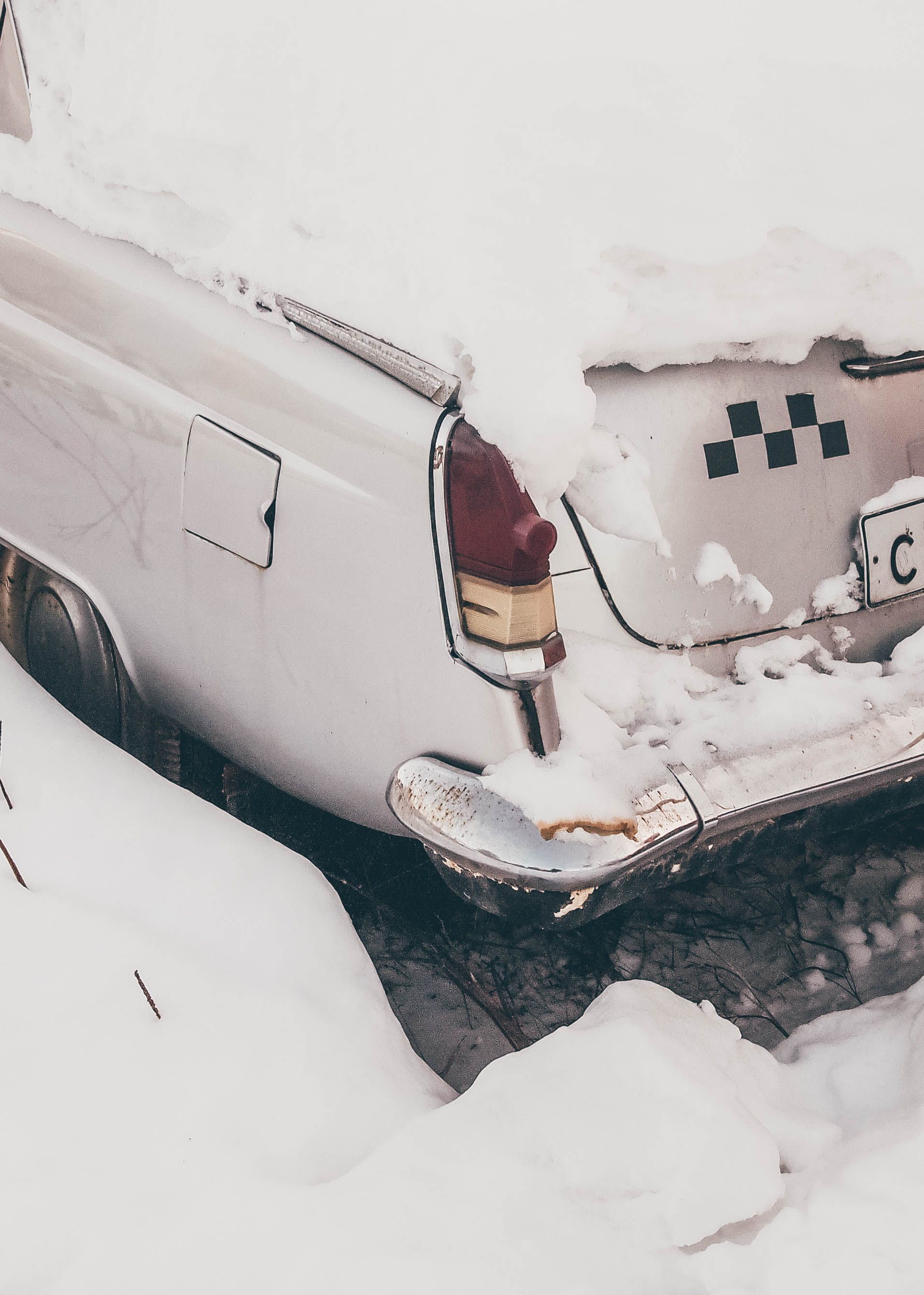 White Car Covered With Snow