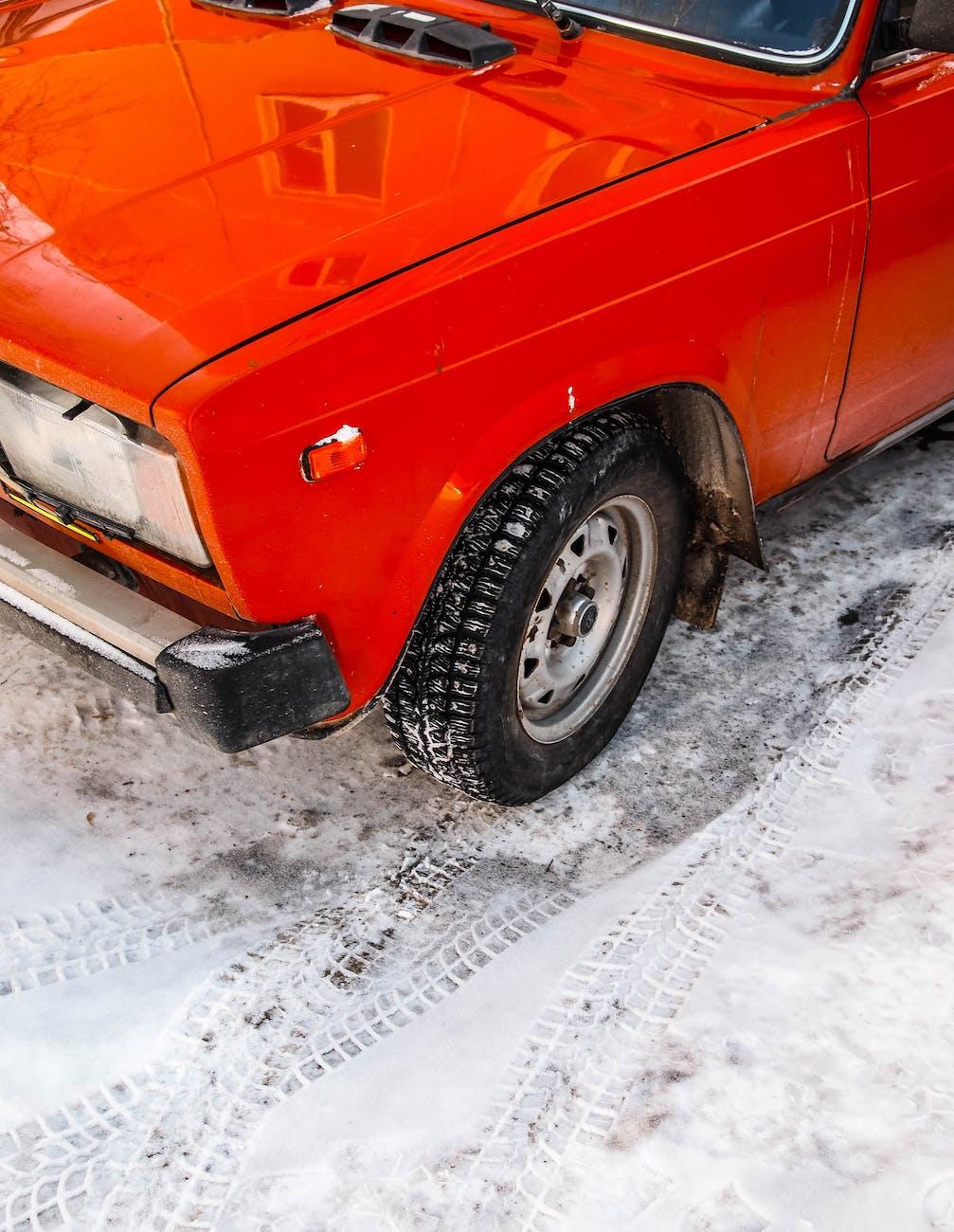 car parked at snow road