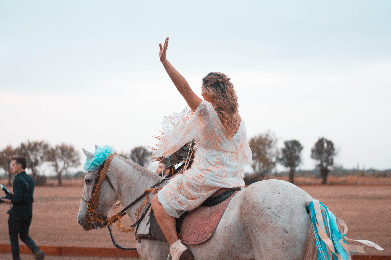 Woman Riding on White Horse