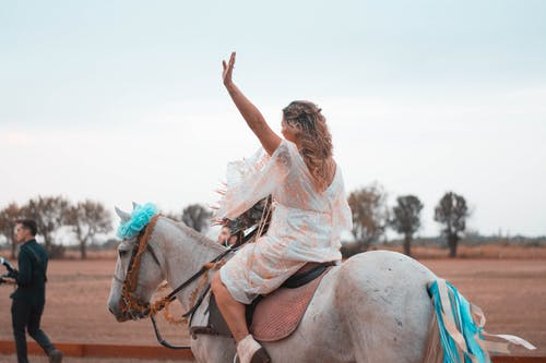 Woman Riding on White Horse