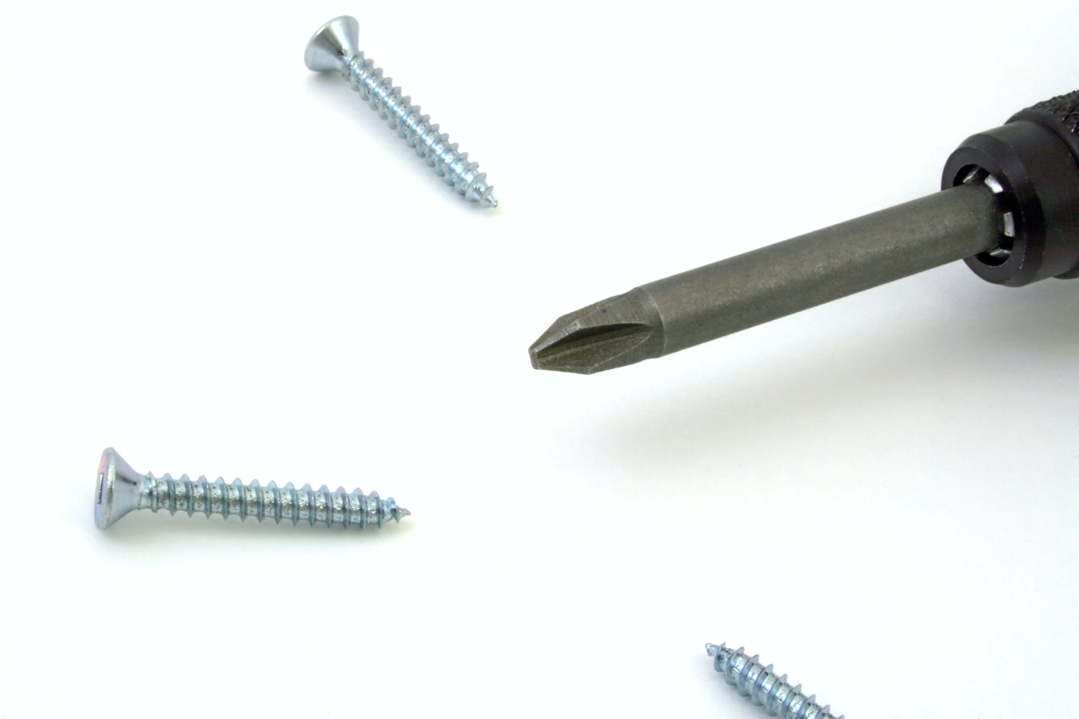 Gray Screw Near Screw Driver