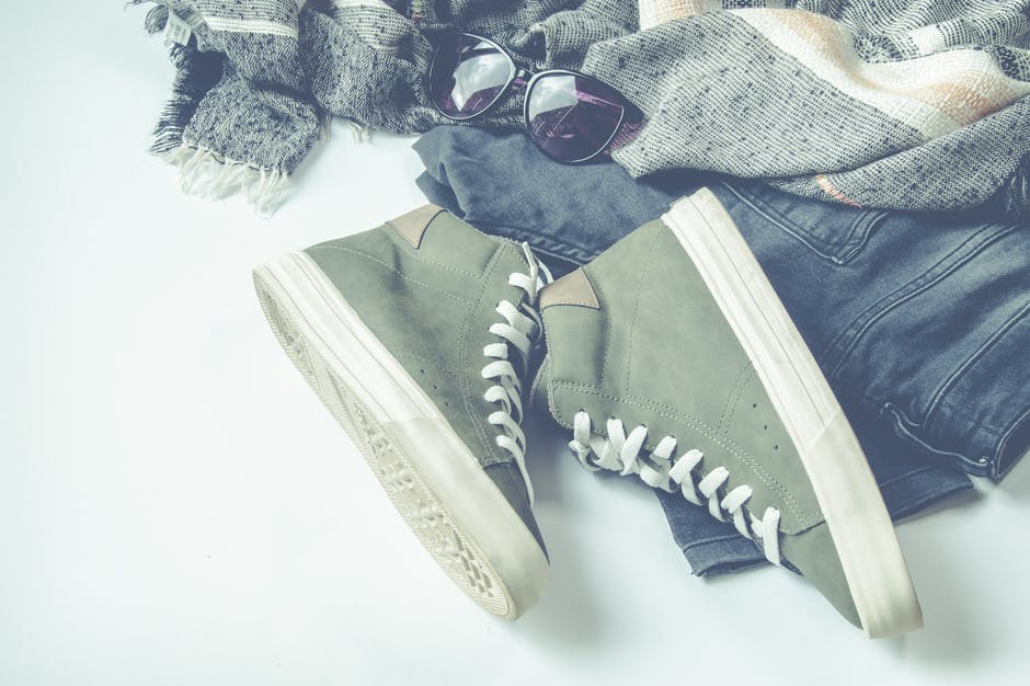 Green High-top Sneakers Beside Bottoms And Sunglasses