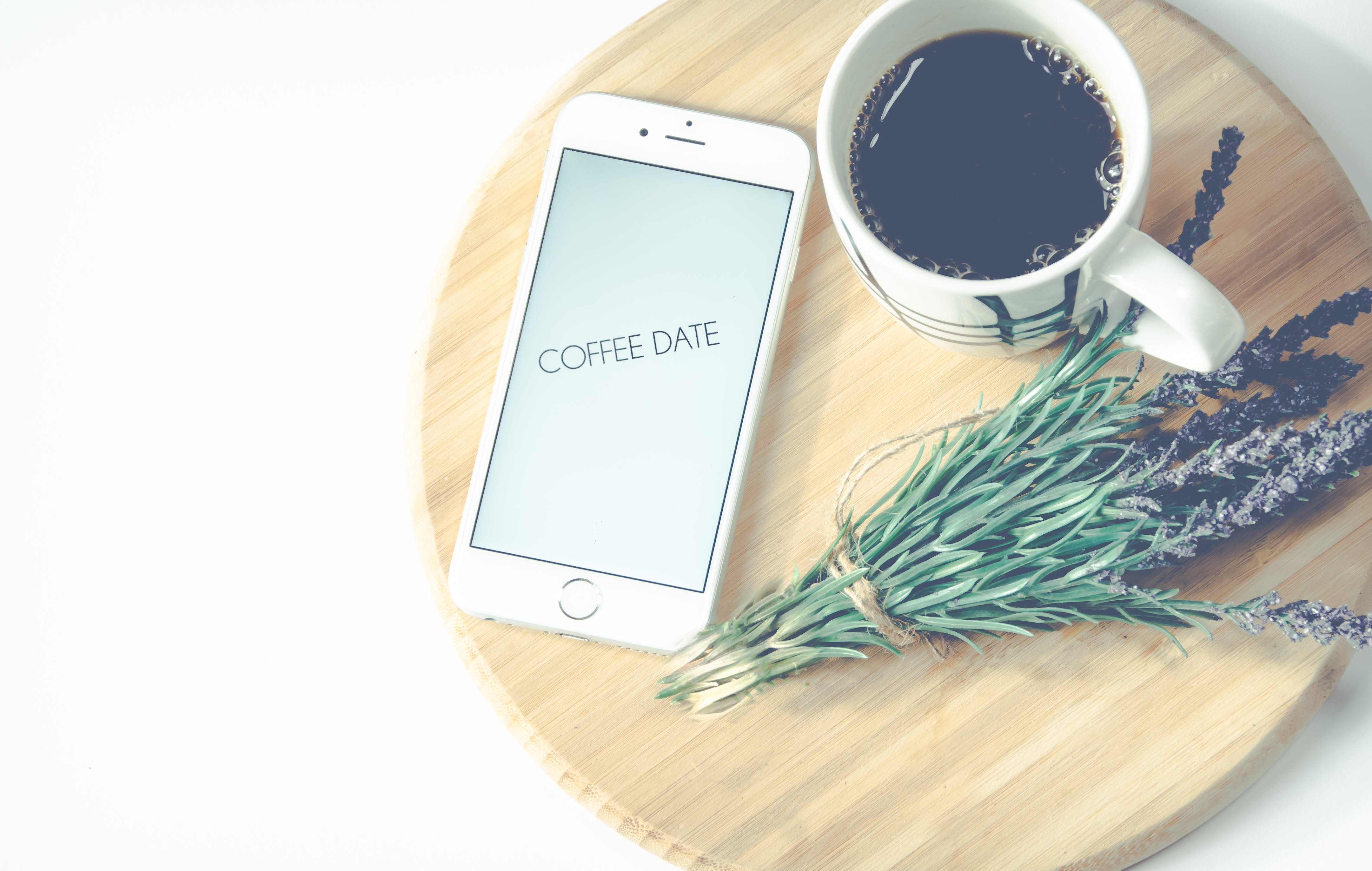 Iphone Beside Coffee And Flower