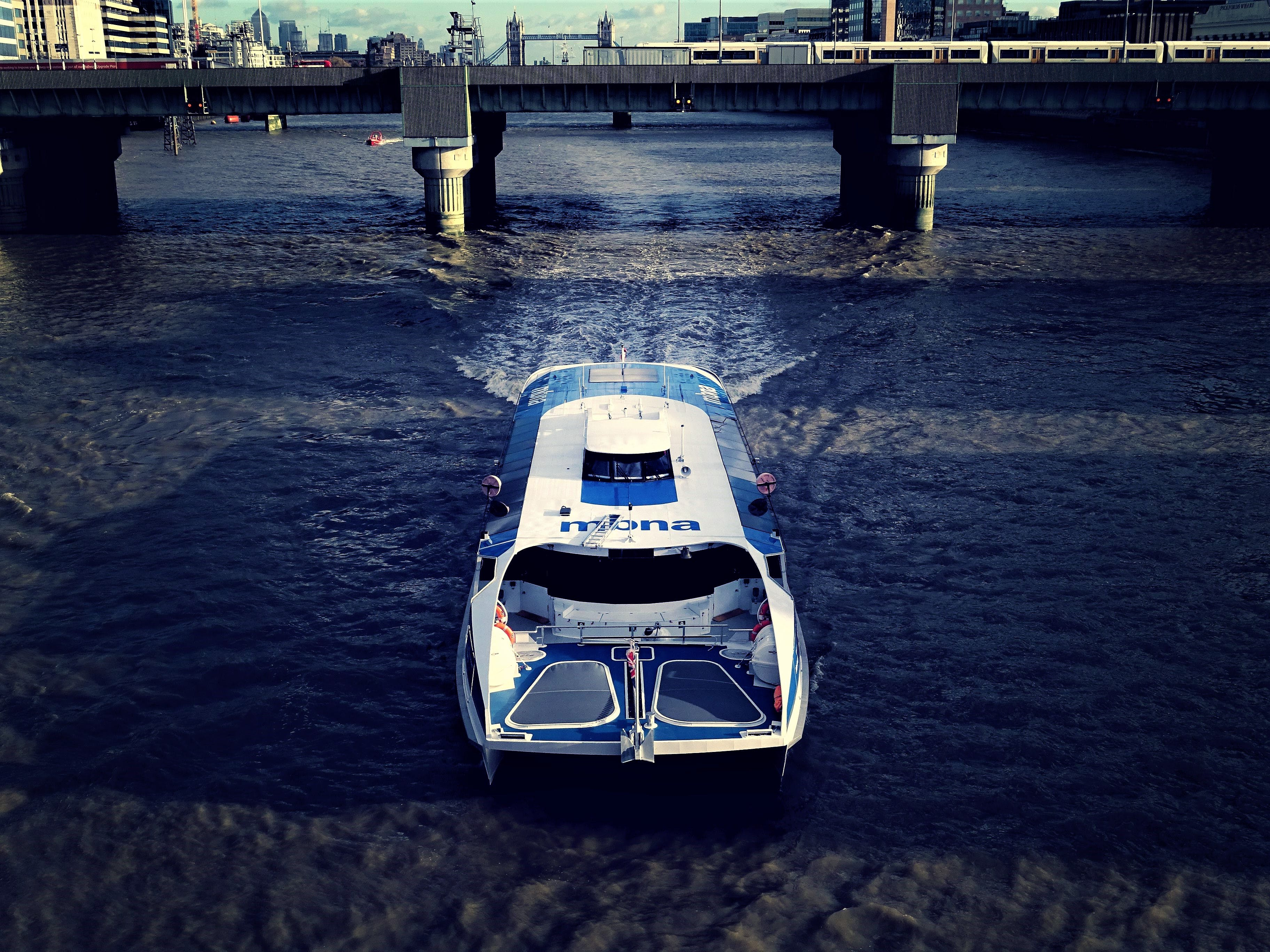 Photography of White And Blue Boat