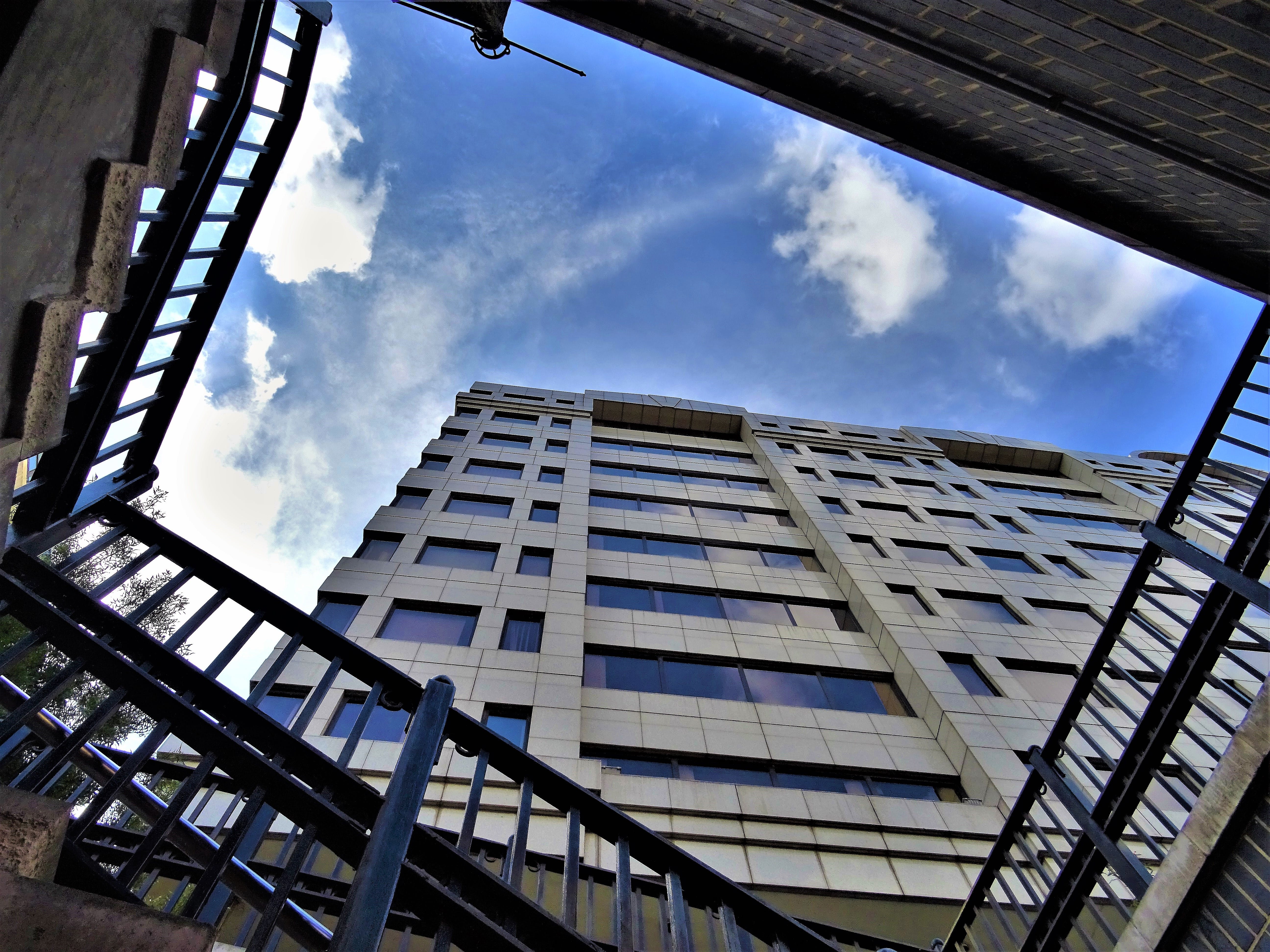 Low-angle Photography of High Rise Building Under Stratus Clouds