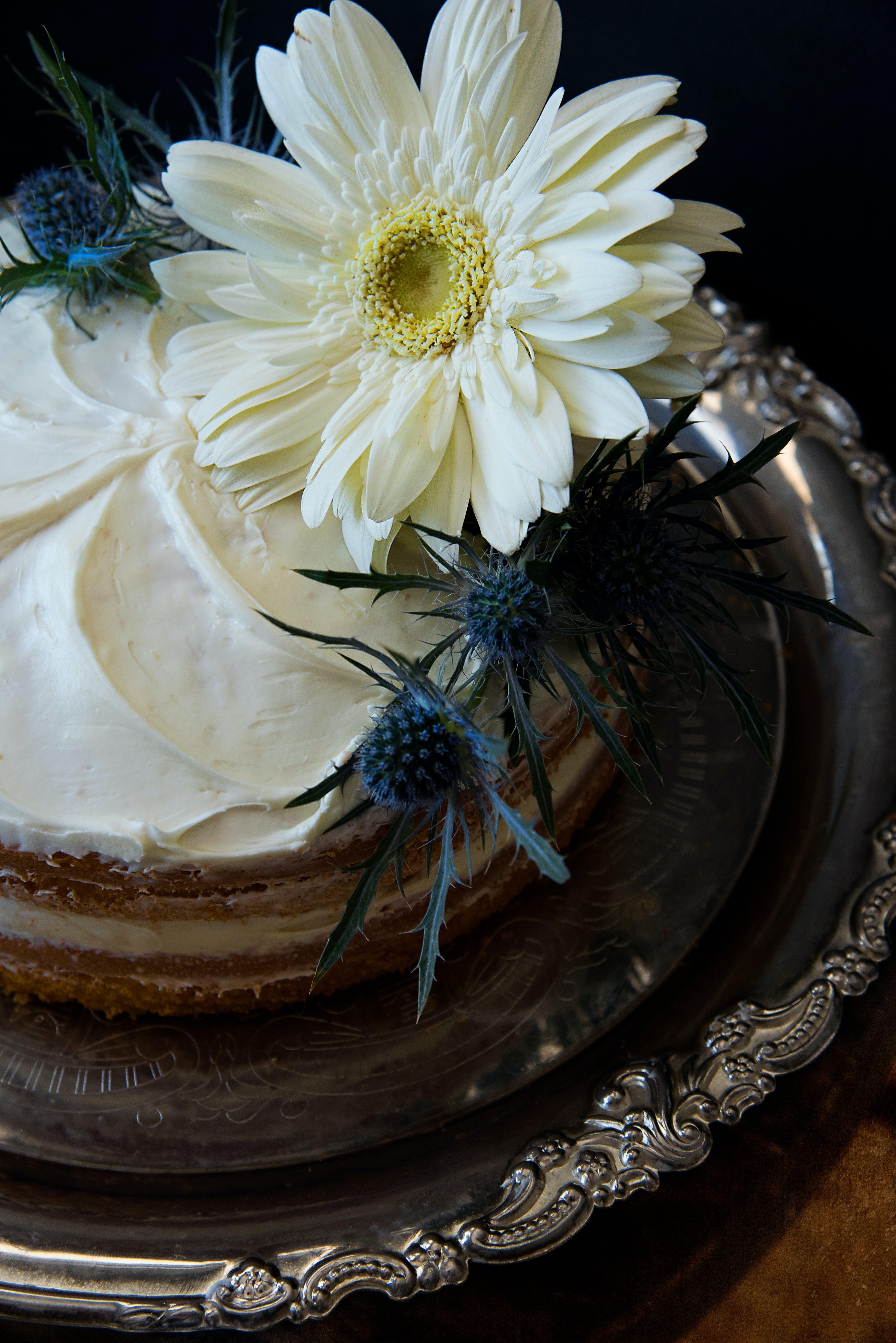 White Flowers on Round Cake With White Cream