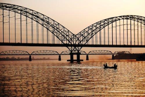 Black Metal Bridge Near on Body of Water