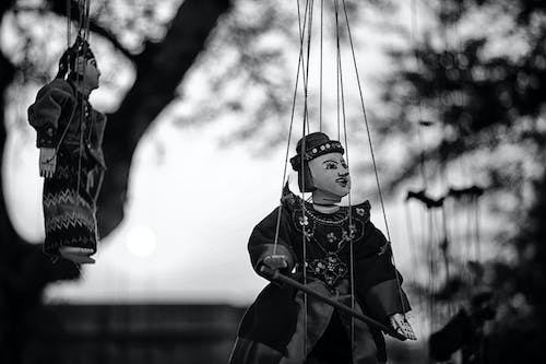 Grayscale of Two String Puppets
