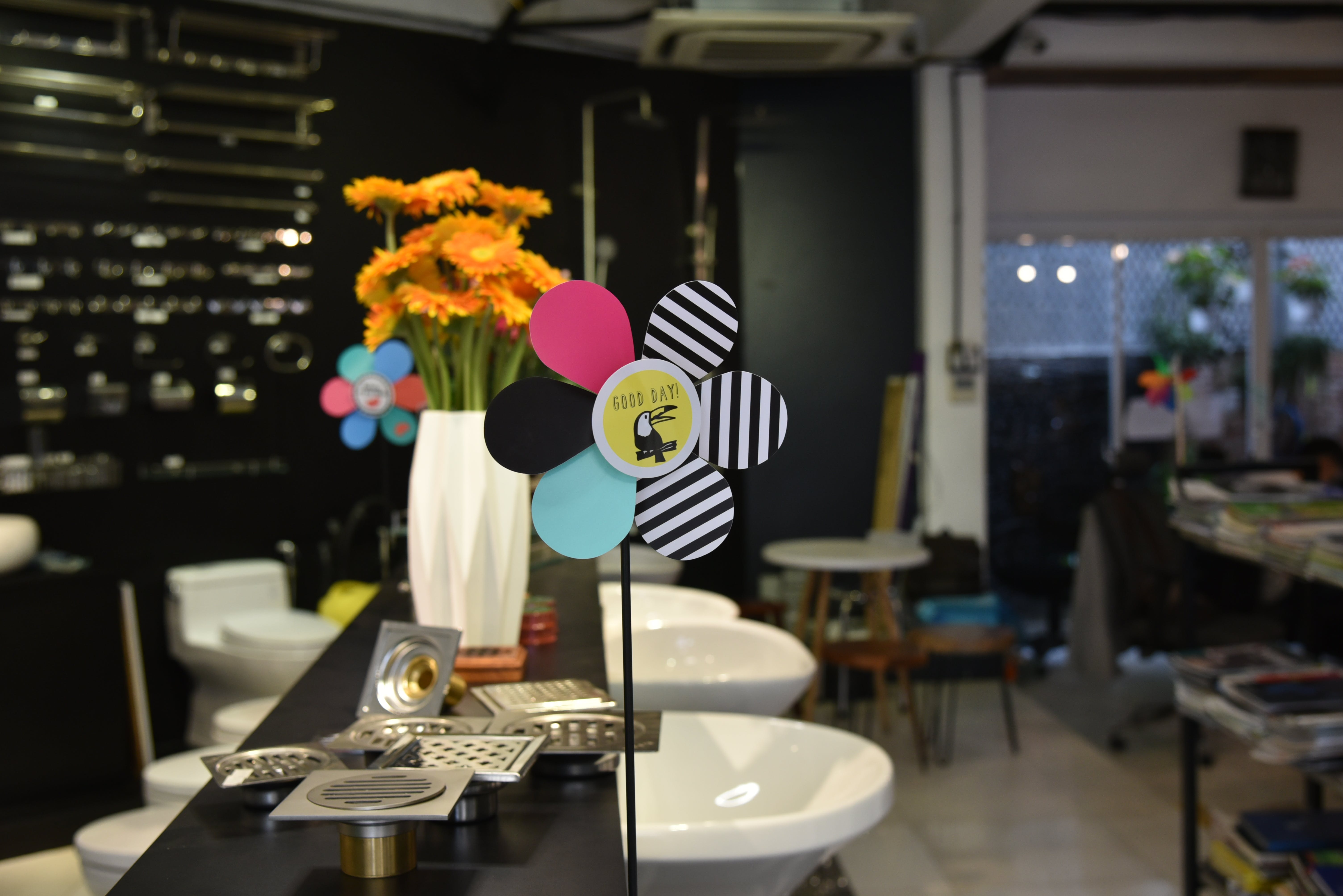 Assorted-color Flower Decoration Beside Stainless Steel Sink Holes