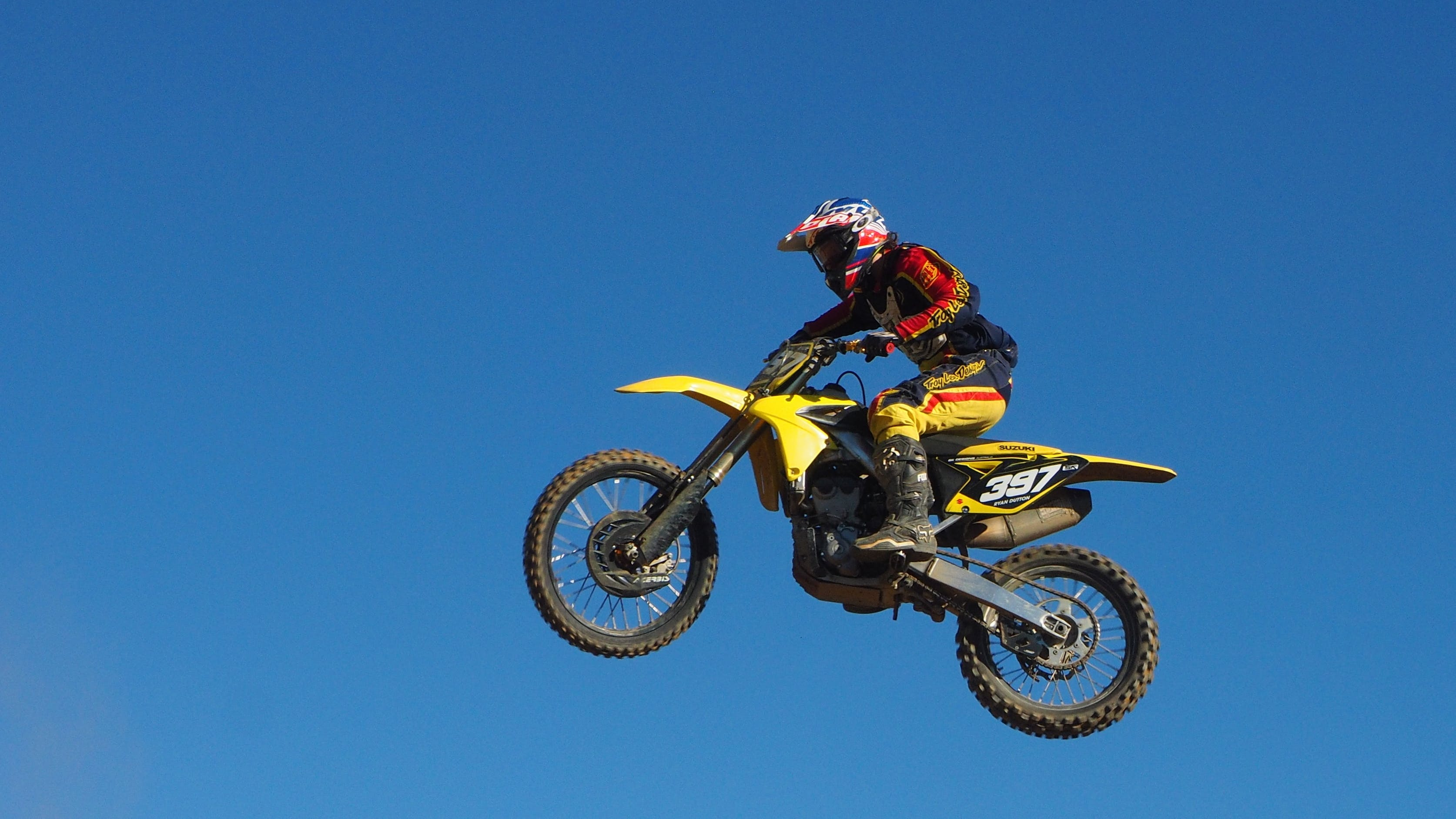 Man Riding Yellow Motocross Dirt Bike