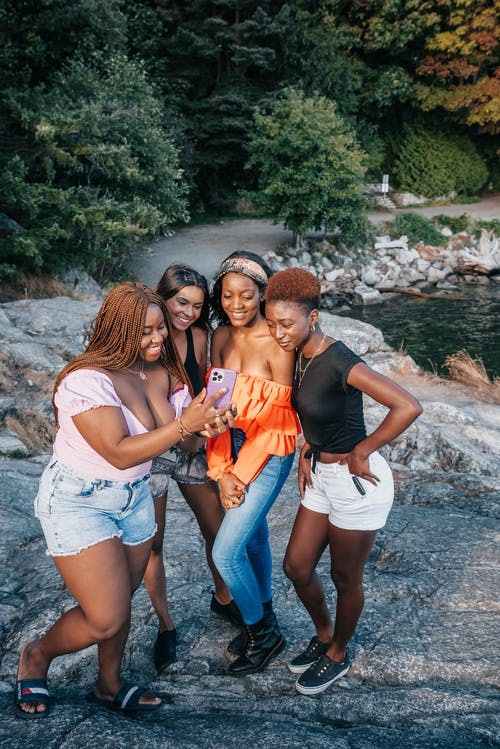 Interracial Group of Women Looking at Mobile Phone