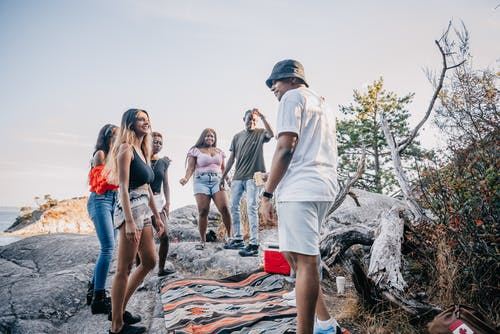 Multiracial Group of Friends Standing on Gray Rock