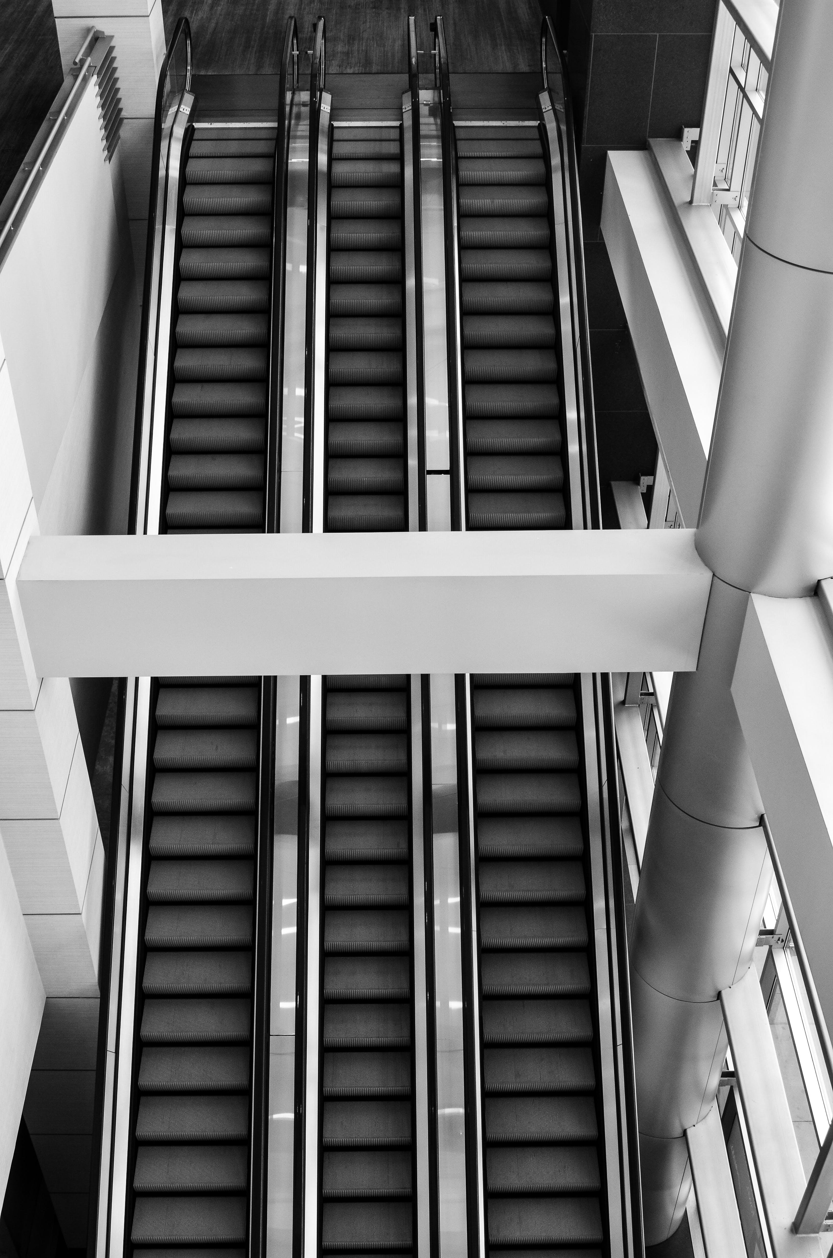 Grayscale Photo of Escalator