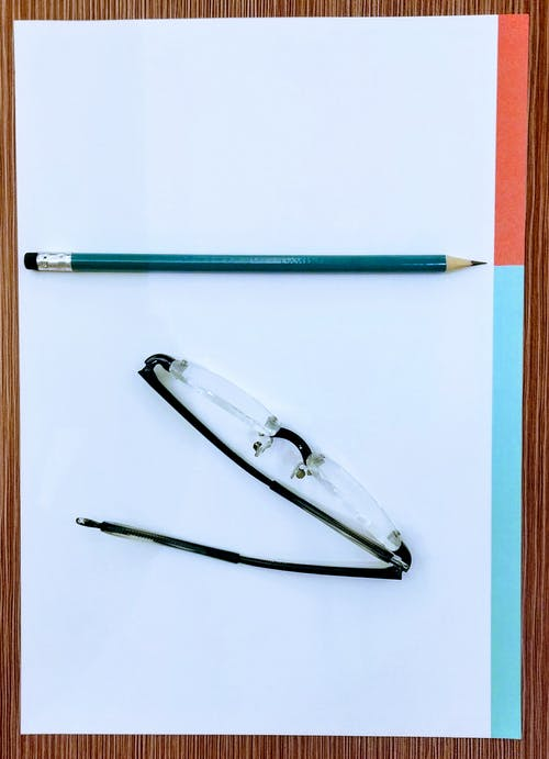 Free stock photo of minimalist, pencil, reading glasses