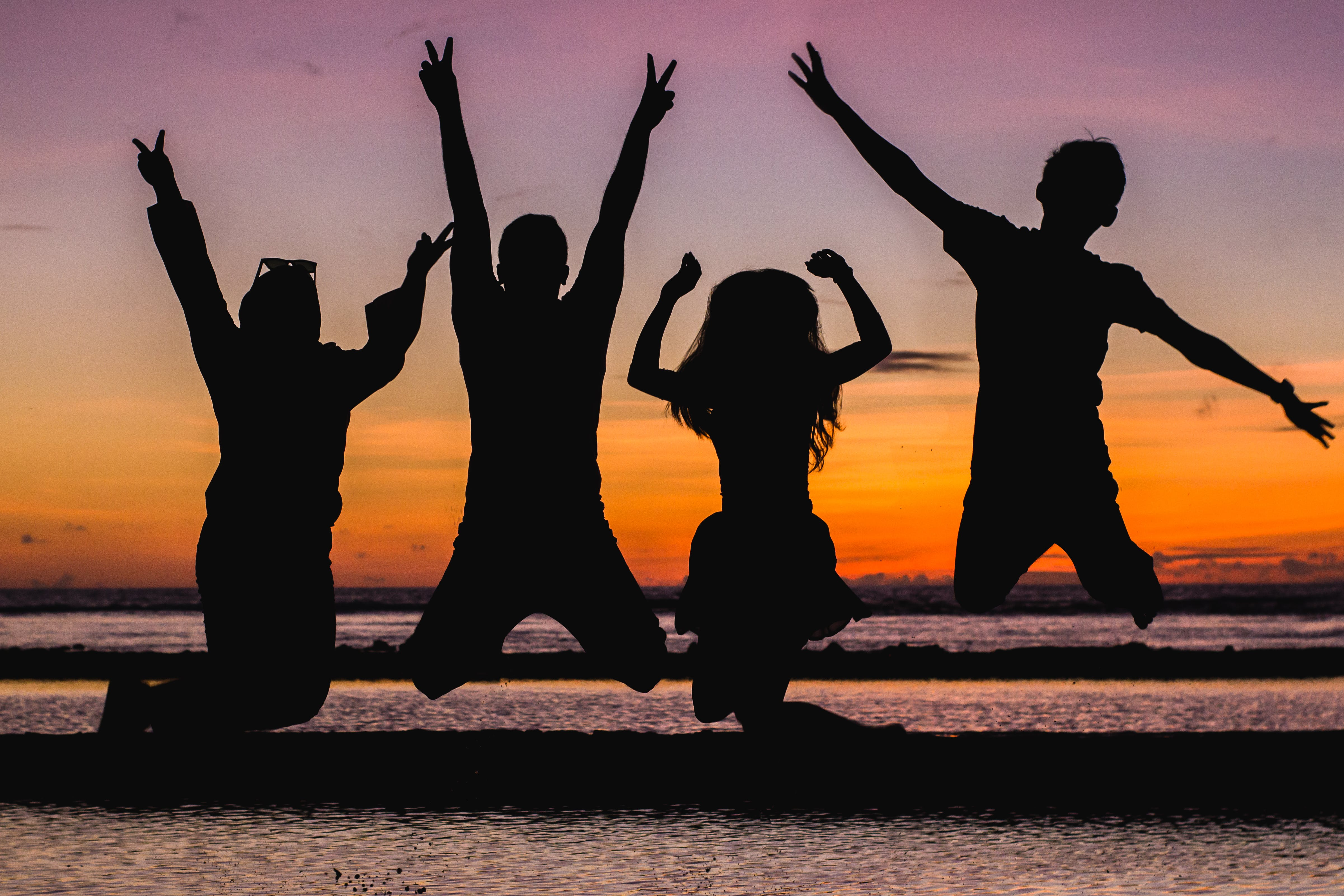 Silhouette of People Jumping