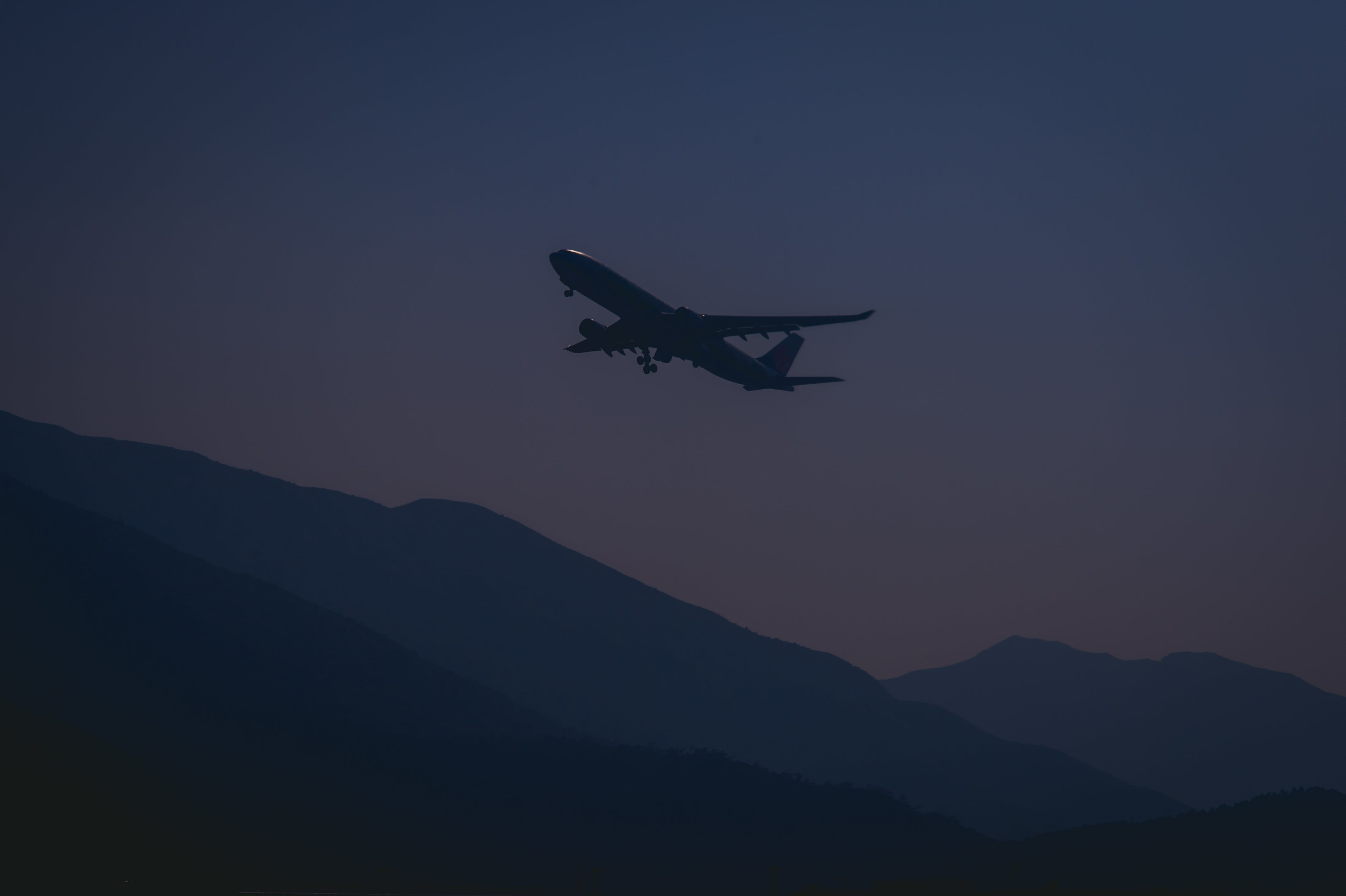 Silhouette of Airplane During Evening
