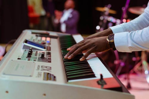 Photo of a Person Playing Electronic Keyboard