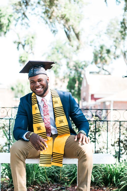 Photo of Man Wearing Graduation Cap