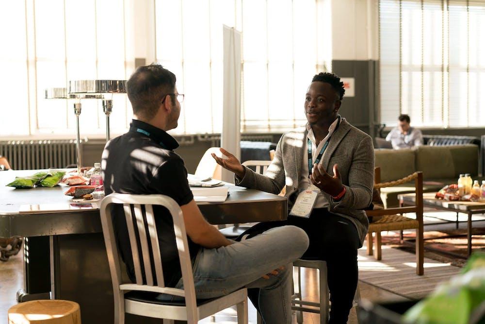 Two men having conversation. | Photo: Pexels