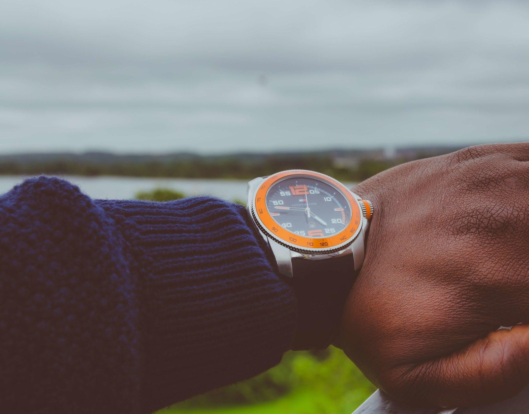 Photo of a Man Wearing Wristwatch