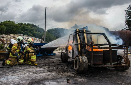 Two Firefighters Extinguish a Car