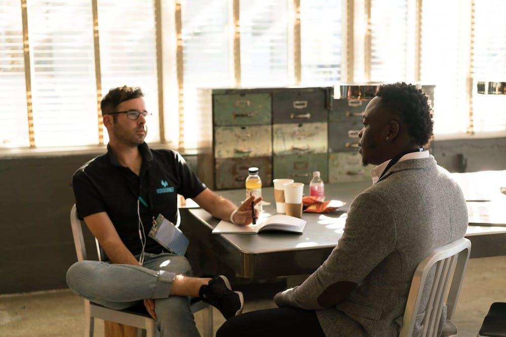 Two men talking. | Photo: Pexels