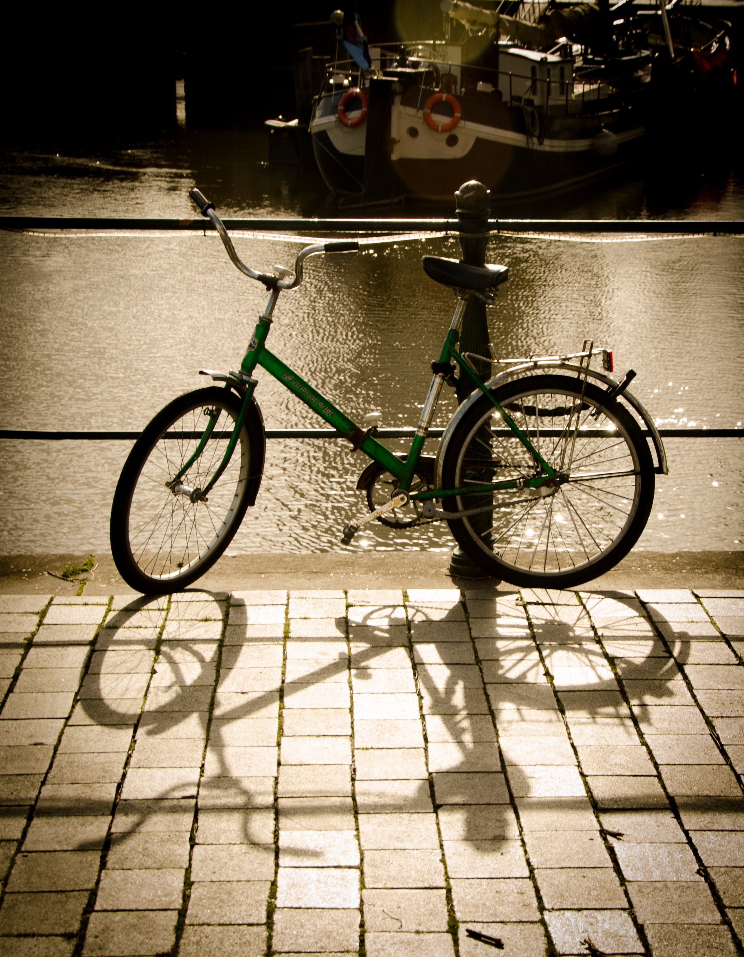 Green Bike Parked Beside the Body of Water