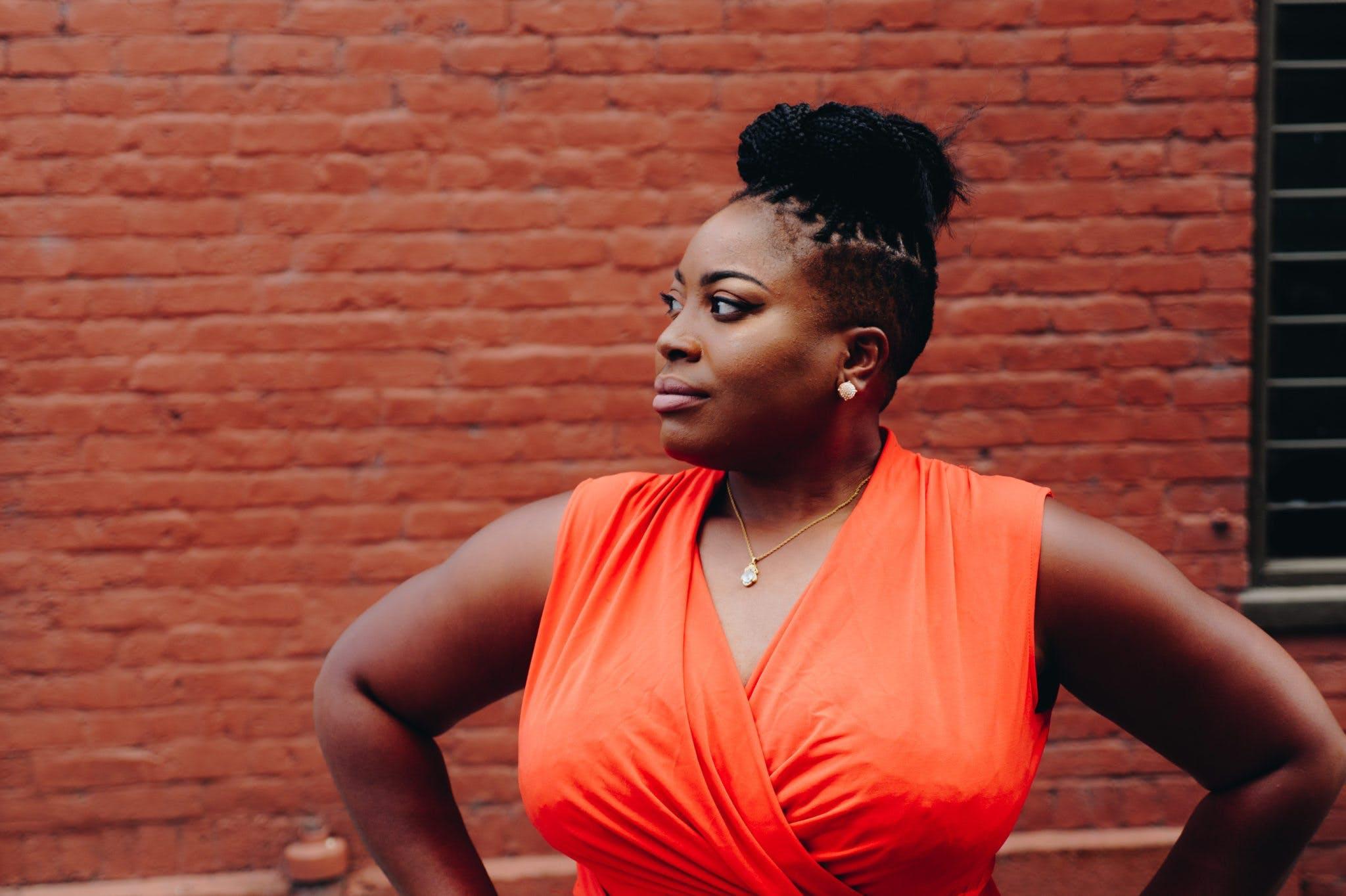 Woman Wearing Orange Sleeveless Top