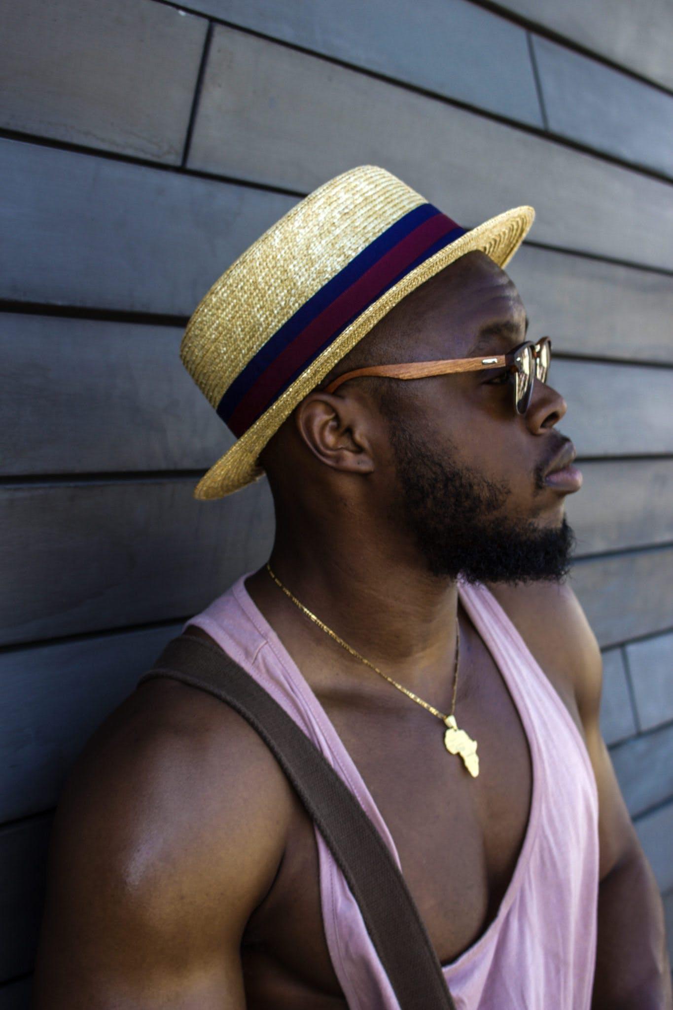 Man Wearing Hat and Pink Tank Top