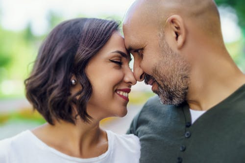 Man and Woman Smiling and Touching Foreheads