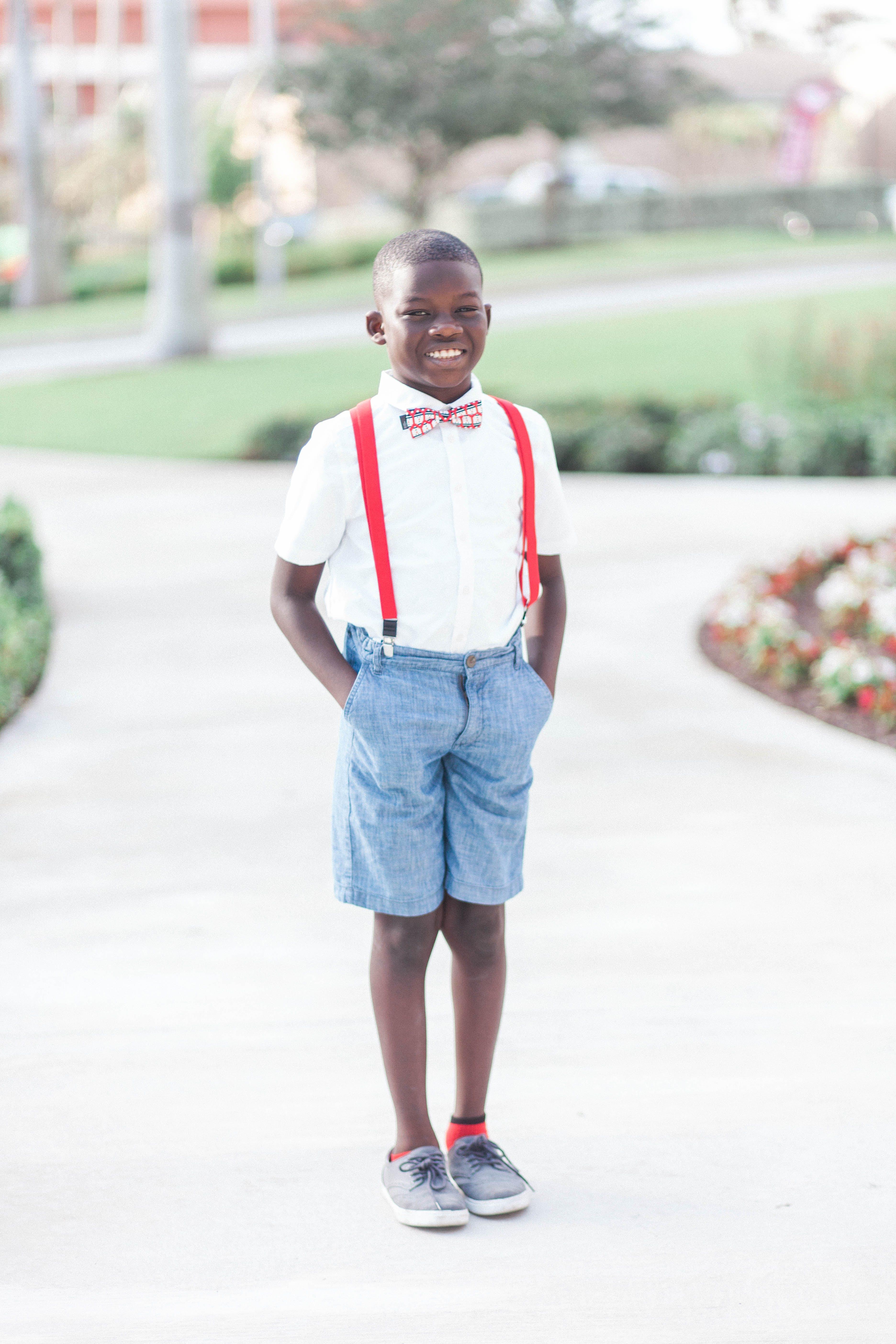 Boy Wearing White Button-down shirt and Blue Denim Shorts