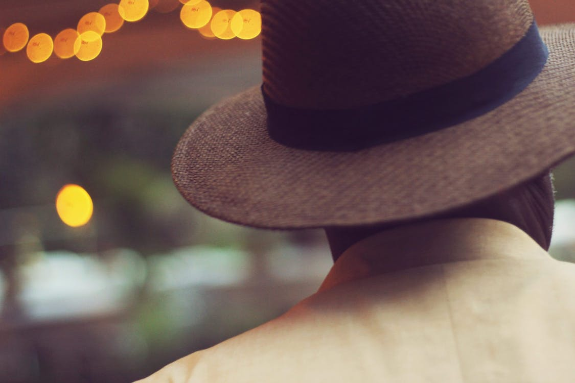 Shallow Focus of Man in Brown Hat